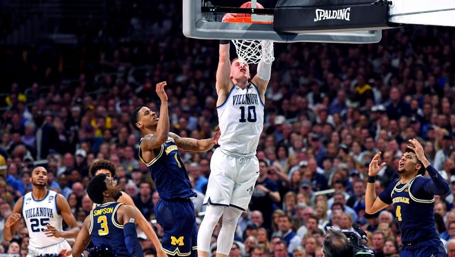 Villanova guard Donte DiVincenzo dunks the ball against Michigan during the championship game of the 2018 NCAA tournament.