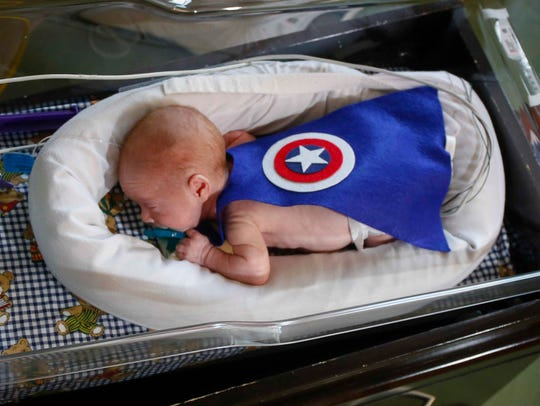 Evan Hjelm wears a Captain America cape on Thursday,