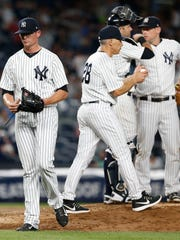 New York Yankees relief pitcher Tyler Clippard (29) leaves the game in the seventh inning after giving up a grand slam to Milwaukee Brewers first baseman Jesus Aguilar (24) at Yankee Stadium on Friday, July 7, 2017.