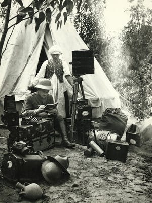 The photo depicts Lowell Thomas, American journalist and traveler, with an assistant on expedition in Asia.