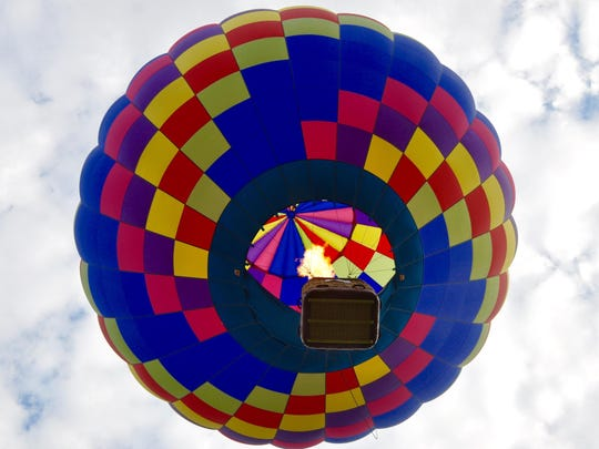 A view from the ground of a balloon in flight at the Stoweflake Balloon Festival.