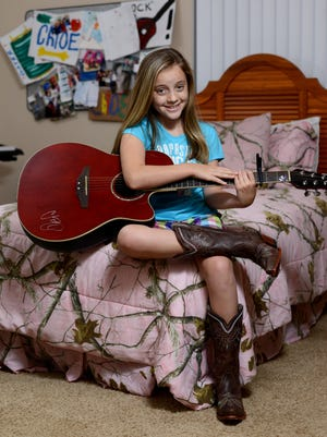 Chloe Channell kicks off the Bands on the Blackwater series in downtown Milton on Friday.