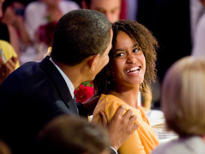 Malia Obama smiles at her father President Barack Obama