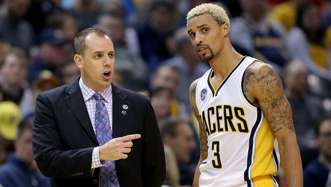 Indiana Pacers head coach Frank Vogel talks with George Hill,right, in the second half of their game Friday, Jan 15, 2016, evening at Bankers Life Fieldhouse. The Pacers lost to the Wizards 104-118.