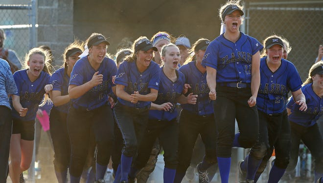 The Franklin Central Flashes celebrates an 8-0 defeat over Center Grove in the sectional final, at Franklin Central, Indianapolis, Wednesday, May 25, 2016.