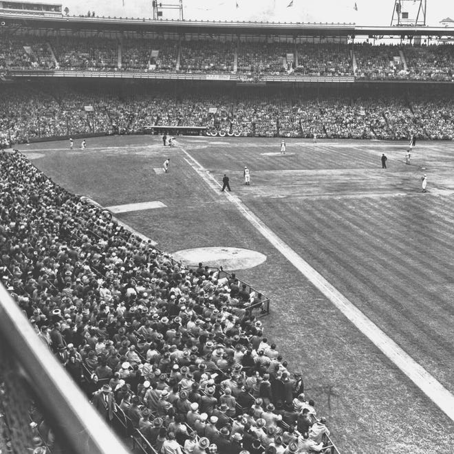 """Crosley Field opened on April 11, 1912 and closed on June 24, 1970 as the Reds were moving to brand new Riverfront Stadium on the river. Enquirer file APRIL 8, 1961: FROM AN ARTICLE BY ALLAN HEIM, ENQUIRER EXECUTIVE SPORTS EDITOR: Opening Day in Cincinnati....unmatched anywhere; 30,000...: Cincinnati takes its annual April holiday Tuesday. The pulse of the city moves to Crosley Field where more than 30,000 optimistic fans will loudly cheer the traditional """"Play Ball"""" cry."""