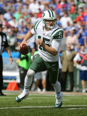 Jets quarterback Josh McCown rolls out of the pocket against the Bills.