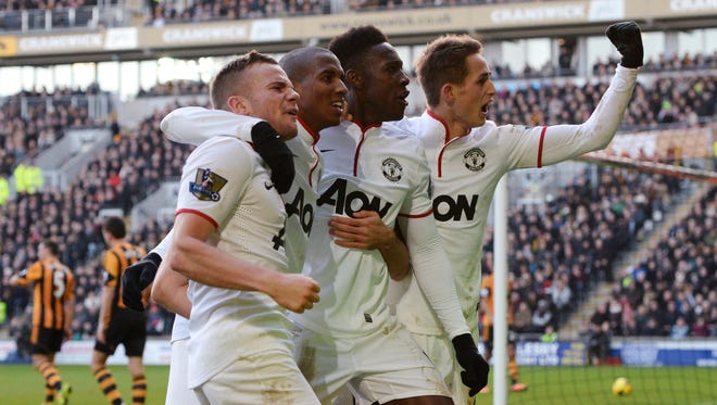 Manchester United players celebrate the goal that gave them a 3-2 lead over Hull City.