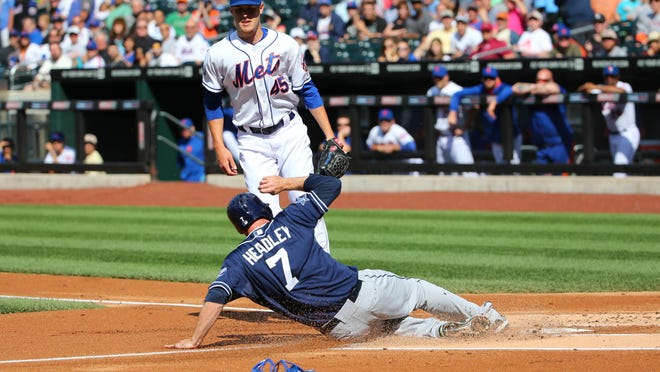 Padres third baseman Chase Headley (7) scores on a wild pitch thrown by Mets pitcher Zack Wheeler (45) in the first inning Saturday.