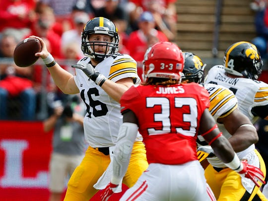 Iowa quarterback C.J. Beathard (16) attempts to pass