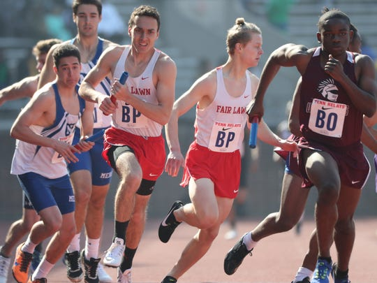 Steven Fried , of Fair Lawn, gets the baton to start the third leg of the 4x400.  Fried ran a 54.23 lap and Fair Lawn came in third place in their heat with a time of 3:36.36. Saturday, April 28, 2018