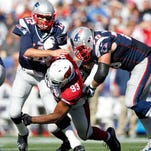 Sept. 16, 2012; Foxboro, Mass.; New England Patriots quarterback Tom Brady is pressured by Arizona Cardinals defensive end Calais Campbell (93) during the fourth quarter at Gillette Stadium. The Cardinals won 20-18.