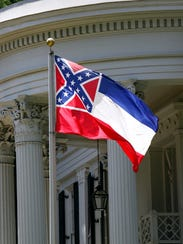 The state flag of Mississippi is seen against the front