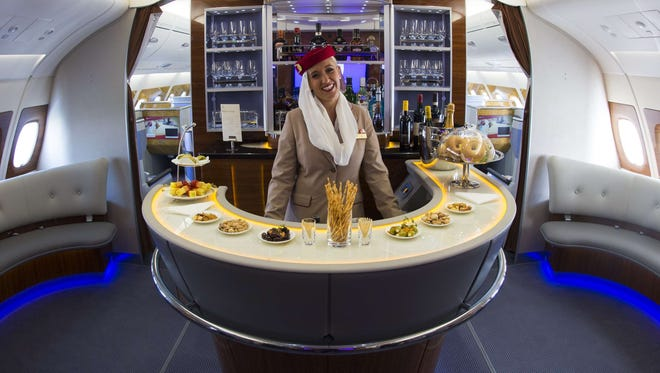 Emirates' A380 planes feature premium-class onboard lounges, shower spas, and complimentary wine and cocktails for even the economy set.