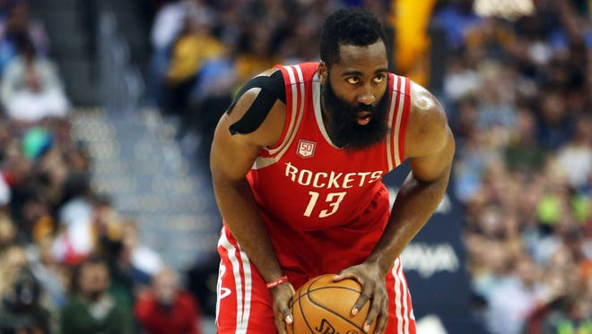 Houston Rockets guard James Harden (13) during the second half against the Denver Nuggets at Pepsi Center.