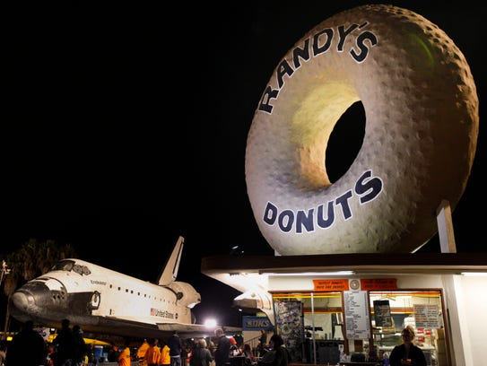 Spectators gather to watch the space shuttle Endeavour