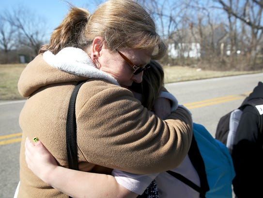 Tonya Yates hugs her granddaughter, Bree Martin, at the time a 3rd grader, after a shooting at Madison Jr/Sr High School in 2016.