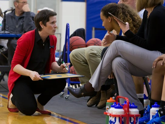 Mercersburg Academy coach Katie LaRue, left, has Michigan