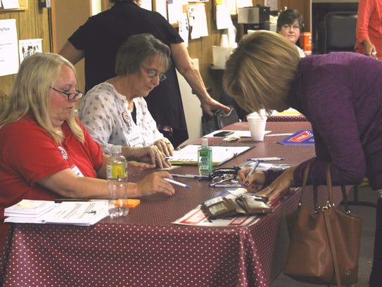 Voters in the J.D. Lewis Senior Citizens Center in