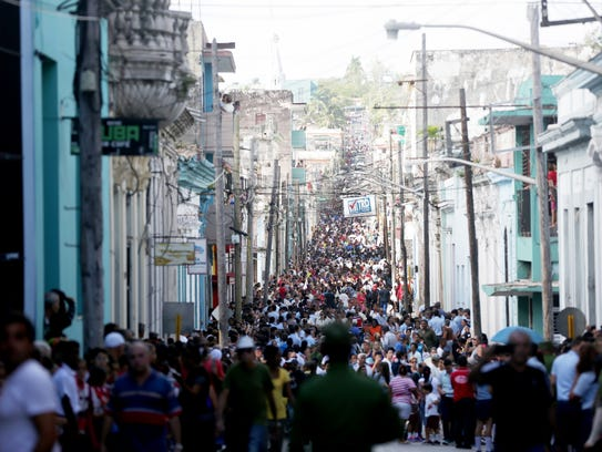 People fill the streets waiting for the Caravana de