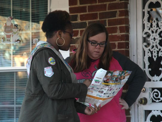 Kaevon Burney of troop 779 sells Girl Scout cookies