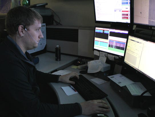 Cody Smiley, a dispatcher with the Portage County Sheriff's Office, works at his desk Jan. 24. Smiley helped a woman disable her out-of-control car on a call earlier in January.