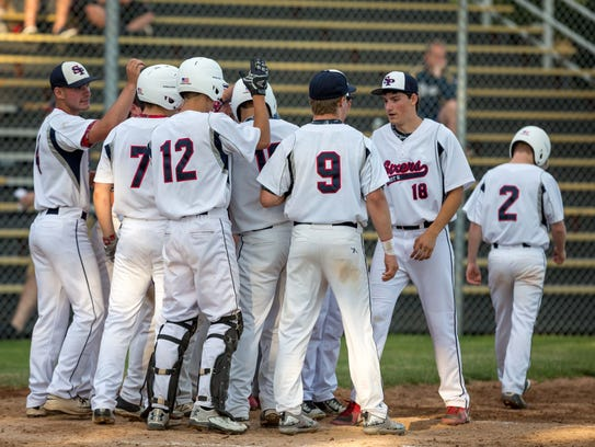 Stevens Point's Cole Wright is mobbed by teammates