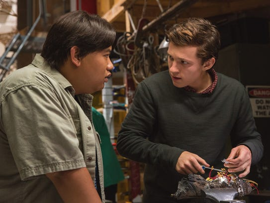 Tom Holland as Peter Parker, right, and Spidey's best