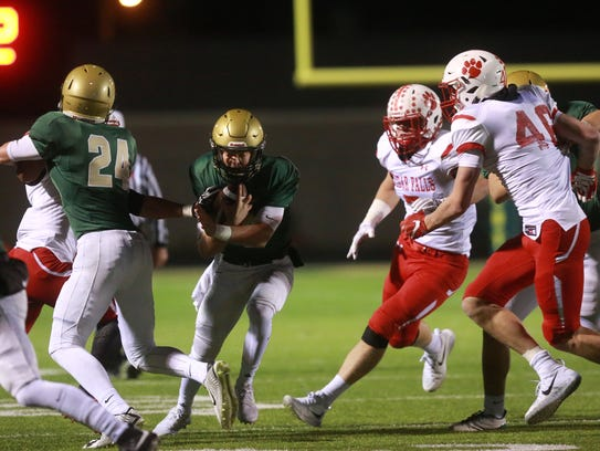 West High quarterback Evan Flitz runs down field during