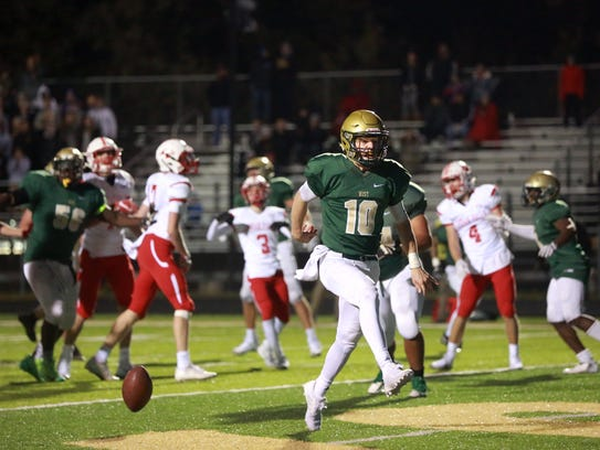 West High quarterback Evan Flitz scores a touchdown
