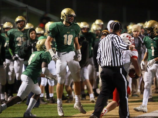 West High's Cole Mabry celebrates a stop during the