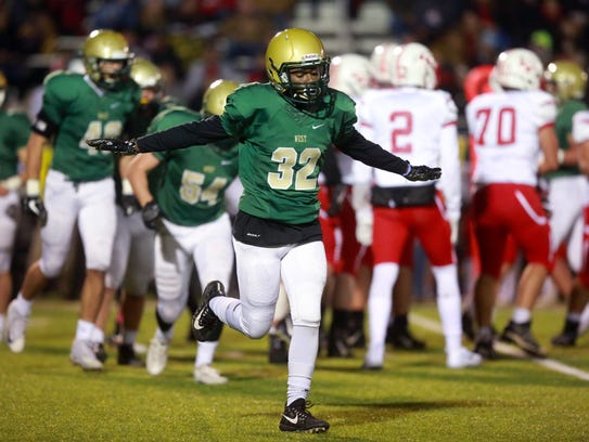 West High's Ryan Kadenge celebrates a stop during the
