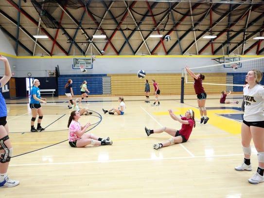 Regina teammates warm up during practice on Monday,
