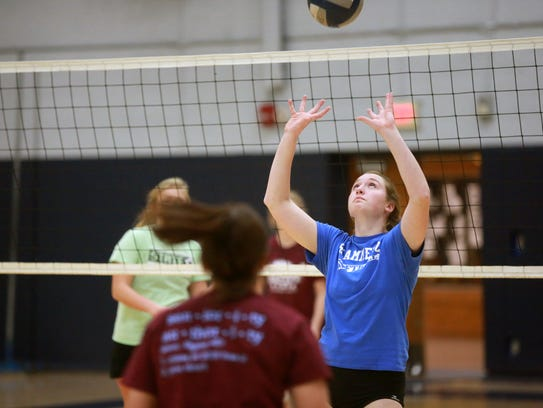 Regina's Alex Wiese sets the ball to teammates during