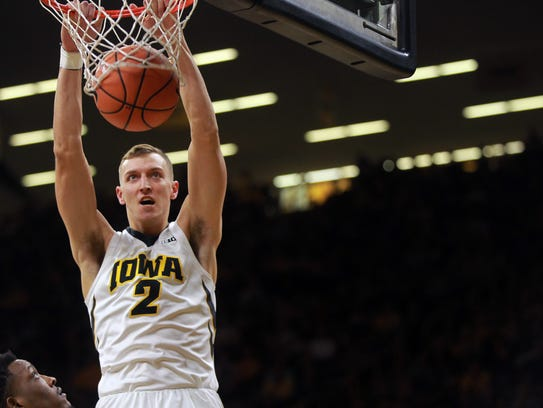 Iowa's Jack Nunge dunks the ball during the Hawkeyes'