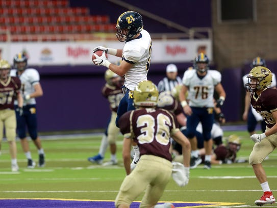 Regina's Jake Phillips pulls in a pass during the Regals'