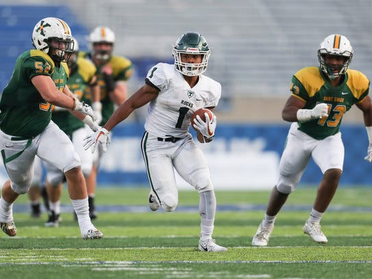 Trinity's Rondale Moore looks for running room in the