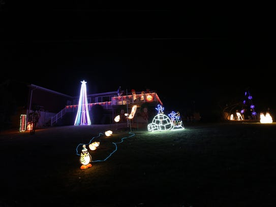 Hope and Dan Pyle's Christmas lights are pictured around