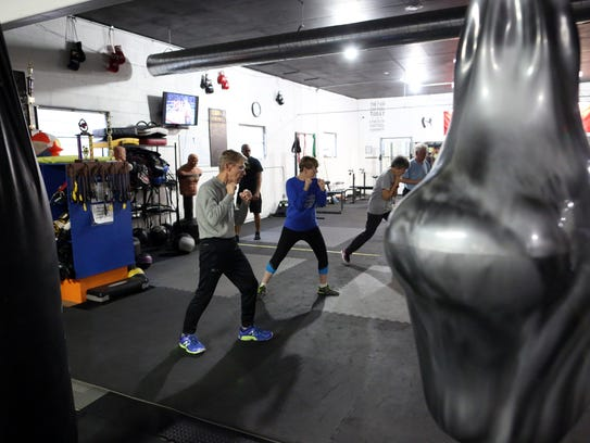 Boxing students run drills during a Rock Steady Boxing
