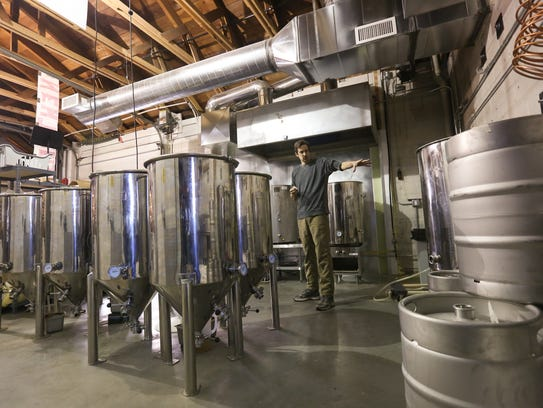 James Kinkade walks through Boot 'n Flute Brewery on