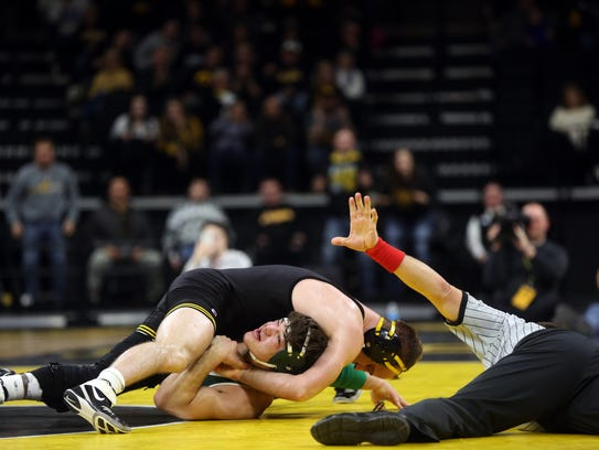 Iowa's Alex Marinelli tries to pin Michigan State's