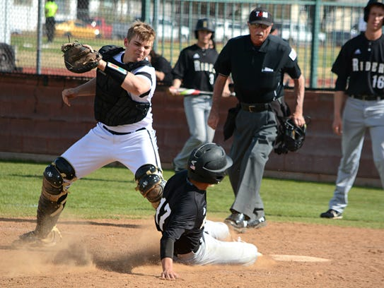 Wichita Falls Rider's Jerry Montijo slides safely into