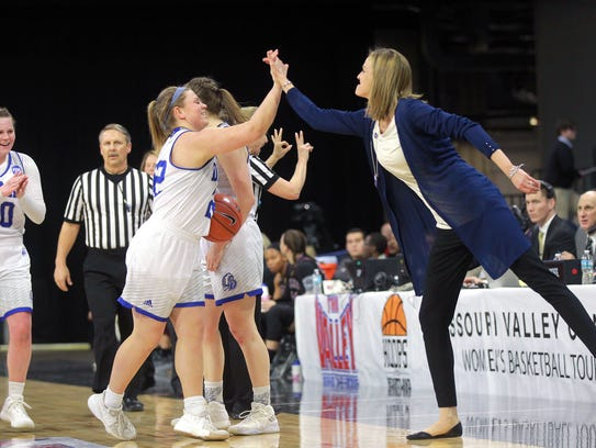 Dake's Hannah Fuller gets a high-five from head coach