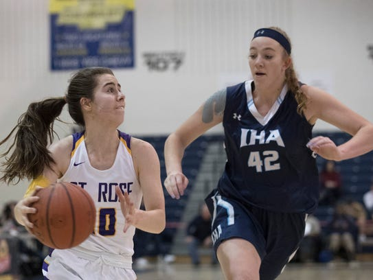St Rose's Mikayla Marham looks to work inside as IHA's