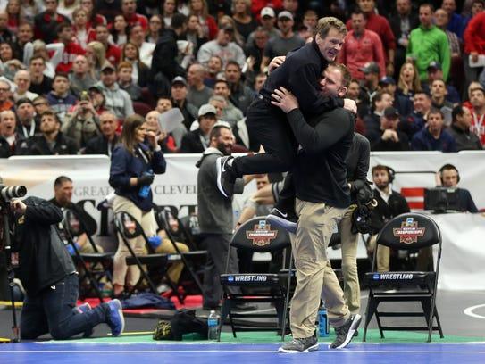Iowa associate head coach Terry Brands celebrates with