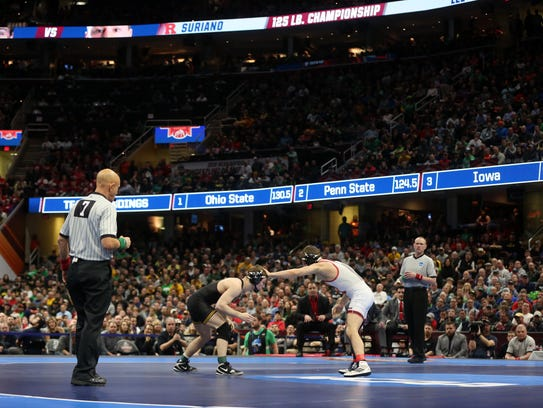 Iowa's Spencer Lee wrestles Rutgers' Nick Suriano in