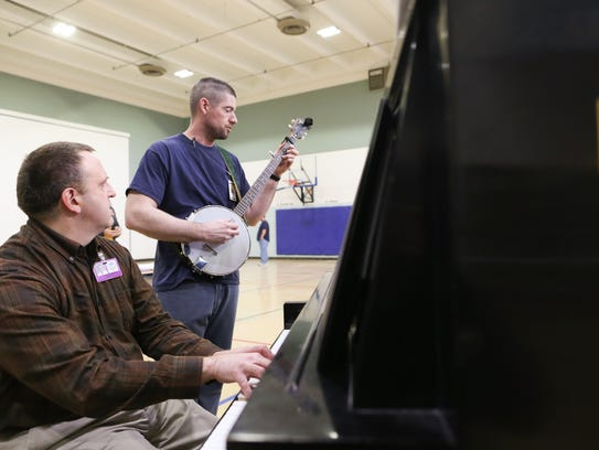 Paul Soderdahl, left, and Shaylan Yeager rehearse music