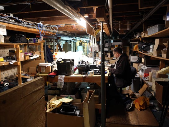 Howard Horan scans film slides in the basement of University