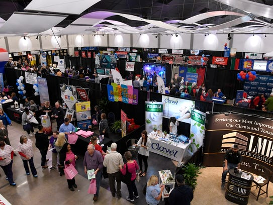 """Visitors wander the exhibition hall during Business EXPO at the Abilene Convention Center Wednesday. This year's theme was """"Let's Make a Deal,"""" with games and prizes on hand at many booths."""