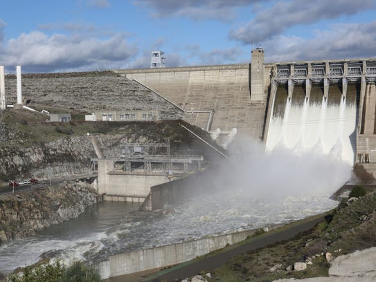 Water rushes out of Folsom Dam in Folsom, California,